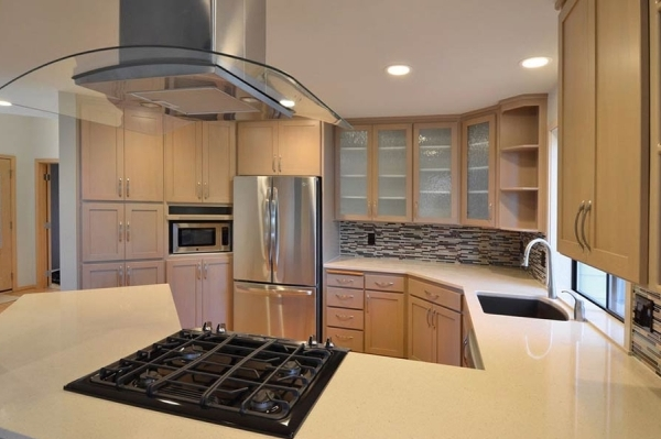 Old oak cabinets that were beautifully restored by Redefine Painting and Design.