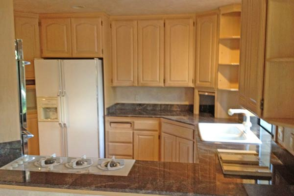 A before picture of old oak cabinets.