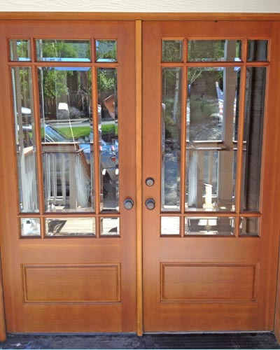 Newly restored and finished exterior wood doors.