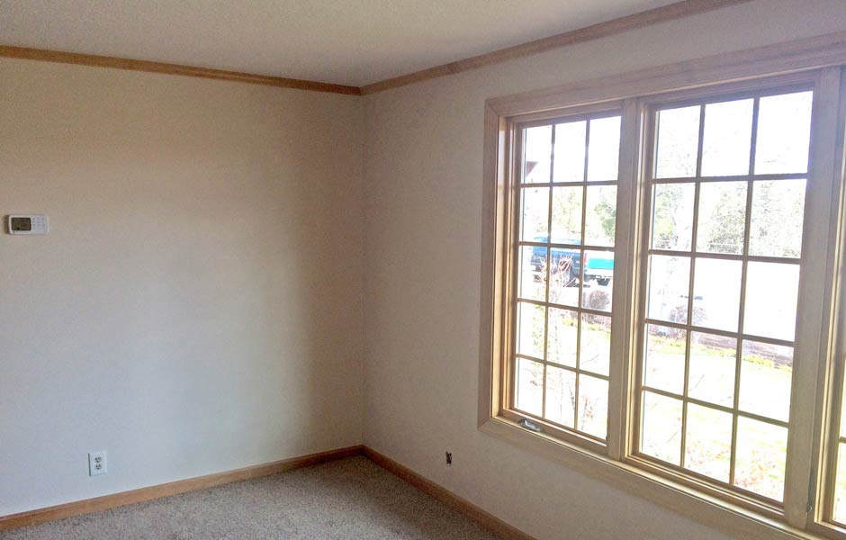 Newly texured and painted walls with a new, larger window installed.