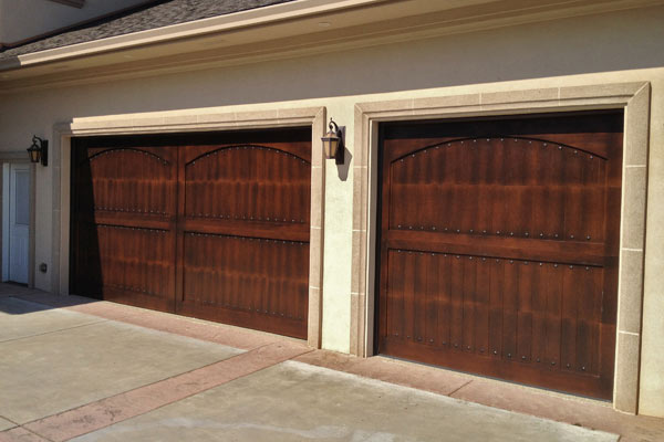 Custom finish on wooden garage doors.