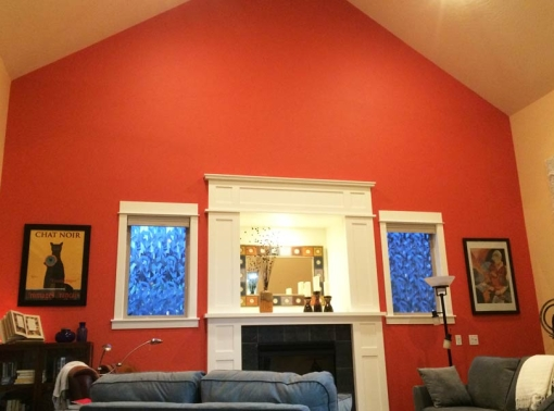 A dramatic orange living room accent wall